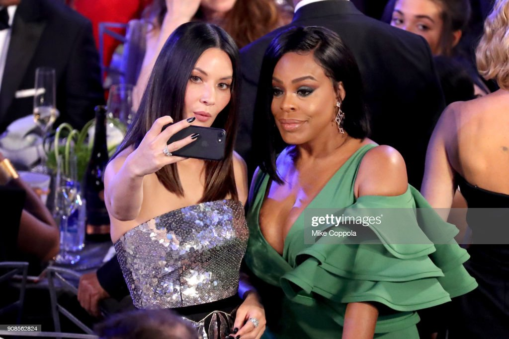 Actors Olivia Munn (L) and Niecy Nash pose for a selfie photo during the 24th Annual Screen Actors Guild Awards at The Shrine Auditorium on January 21, 2018 in Los Angeles, California. 27522_014