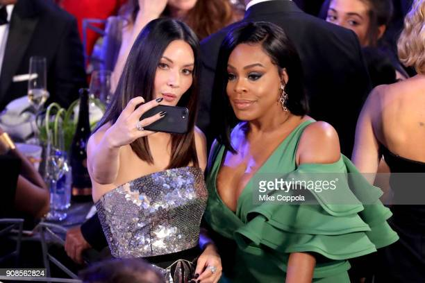 Actors Olivia Munn and Niecy Nash pose for a selfie photo during the 24th Annual Screen Actors Guild Awards at The Shrine Auditorium on January 21...