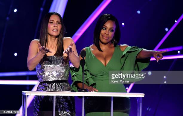 Actors Olivia Munn and Niecy Nash speak onstage during the 24th Annual Screen Actors Guild Awards at The Shrine Auditorium on January 21 2018 in Los...