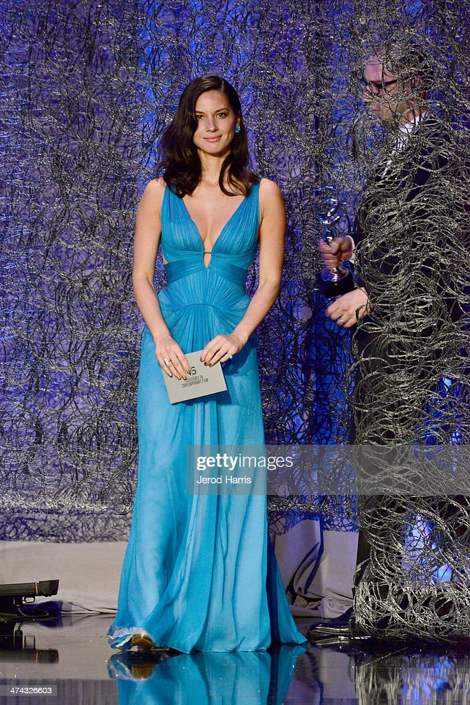 Actors Olivia Munn (L) and Tony Hale speak onstage during the 16th Costume Designers Guild Awards with presenting sponsor Lacoste at The Beverly Hilton Hotel on February 22, 2014 in Beverly Hills, California.
