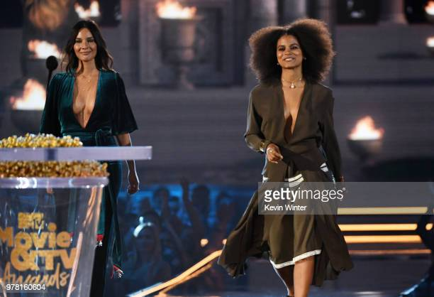Actors Olivia Munn and Zazie Beetz walk onstage during the 2018 MTV Movie And TV Awards at Barker Hangar on June 16 2018 in Santa Monica California