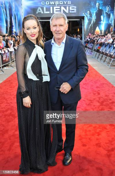 Actors Olivia Wilde and Harrison Ford attend the Cowboys Aliens UK premiere at Cineworld 02 Arena on August 11 2011 in London England