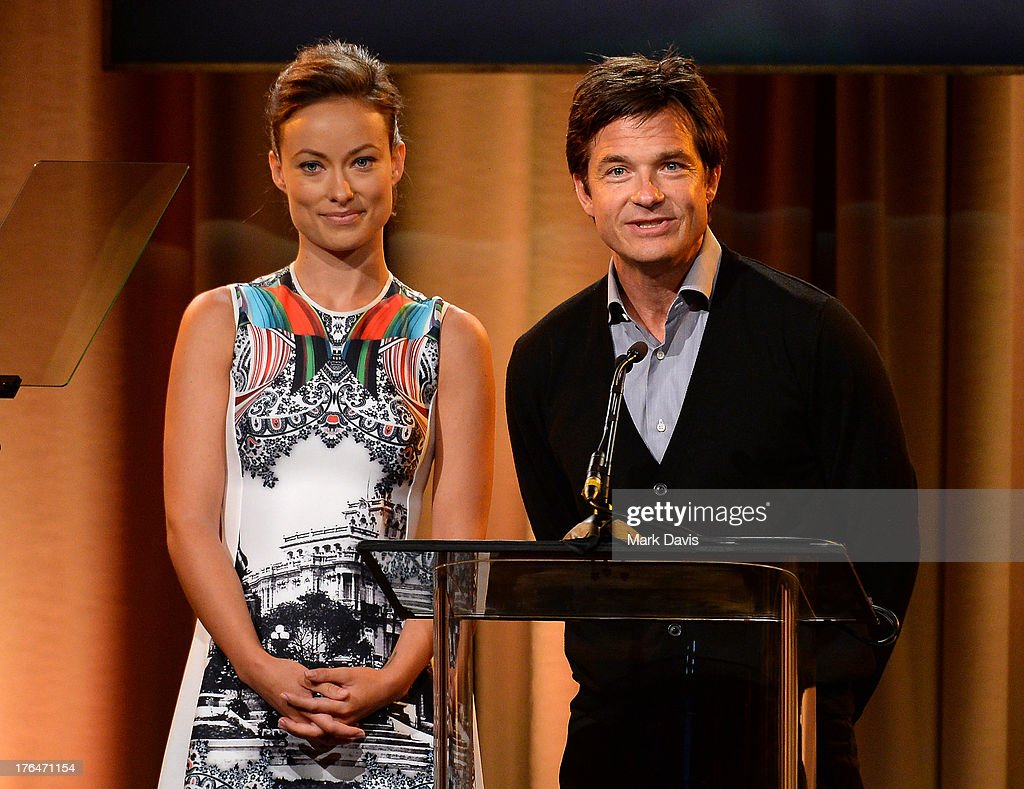 Actors Olivia Wilde and Jason Bateman speak onstage at the Hollywood Foreign Press Association's 2013 Installation Luncheon at The Beverly Hilton Hotel on August 13, 2013 in Beverly Hills, California.