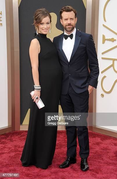 Actors Olivia Wilde and Jason Sudeikis arrive at the 86th Annual Academy Awards at Hollywood Highland Center on March 2 2014 in Hollywood California
