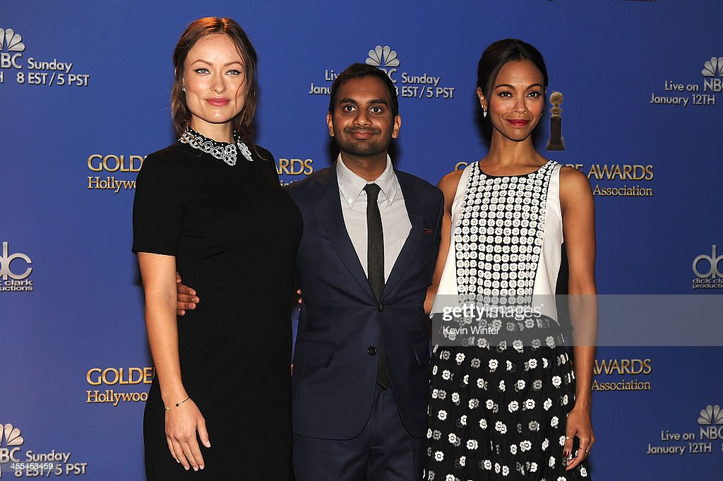 Actors Olivia Wilde, Aziz Ansari and Zoe Saldana stand onstage at the 71st Golden Globe Awards Nominations Announcement at The Beverly Hilton Hotel on December 12, 2013 in Beverly Hills, California.