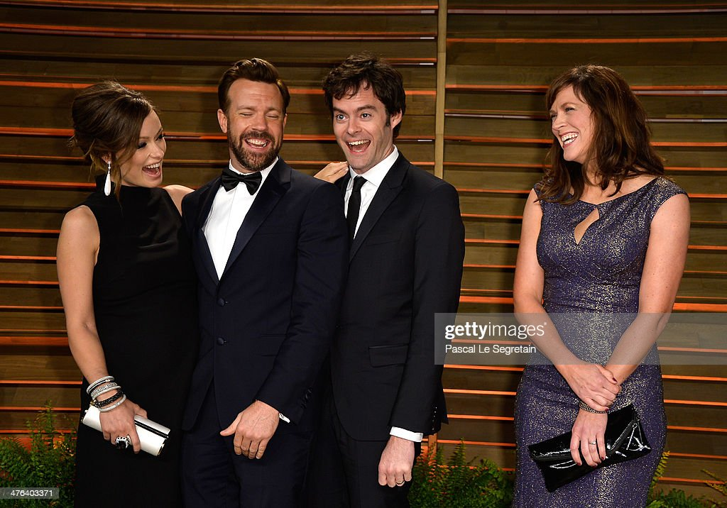 Actors Olivia Wilde, Jason Sudeikis, Bill Hader and writer/director Maggie Carey attend the 2014 Vanity Fair Oscar Party hosted by Graydon Carter on March 2, 2014 in West Hollywood, California.