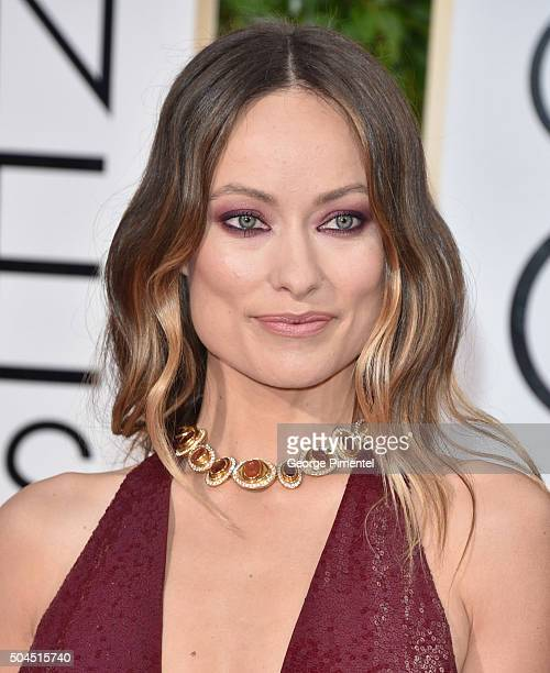 Actors Olivia Wilde jewelry detail attends the 73rd Annual Golden Globe Awards held at the Beverly Hilton Hotel on January 10 2016 in Beverly Hills...