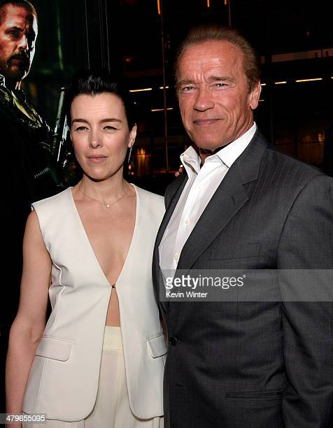 """Actors Olivia Williams and Arnold Schwarzenegger arrive at the premiere of Open Road Films' """"Sabotage"""" at the Regal Cinemas L.A. Live on March 19,..."""