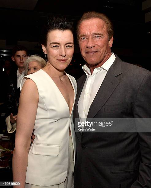 Actors Olivia Williams and Arnold Schwarzenegger pose at the after party for the premiere of Open Road Films' 'Sabotage' at the Lucky Strike Bowling...