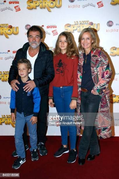 Actors Olivier Marchal Catherine Marchal and their children Ninon and Basile attend the Le Petit Spirou Paris Premiere at Le Grand Rex on September...