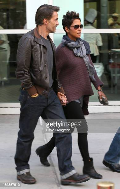 Actors Olivier Martinez and Halle Berry are seen at the ArcLight Cinemas on May 23 2013 in Los Angeles California
