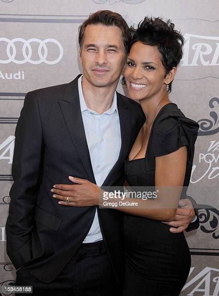 Actors Olivier Martinez and Halle Berry arrive at Variety's 4th Annual Power Of Women event at the Beverly Wilshire Four Seasons Hotel on October 5...