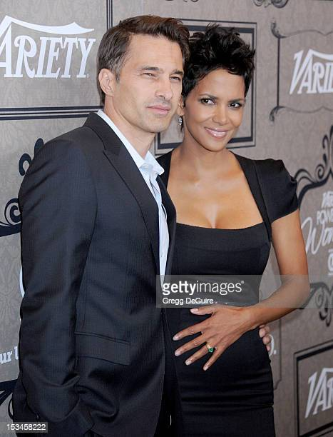 Actors Olivier Martinez and Halle Berry arrive at Variety's 4th Annual Power Of Women event at the Beverly Wilshire Four Seasons Hotel on October 5,...