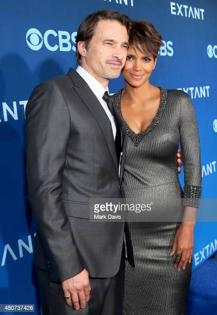"""Actors Olivier Martinez and Halle Berry attend Premiere Of CBS Television Studios & Amblin Television's """"Extant"""" at California Science Center on June..."""