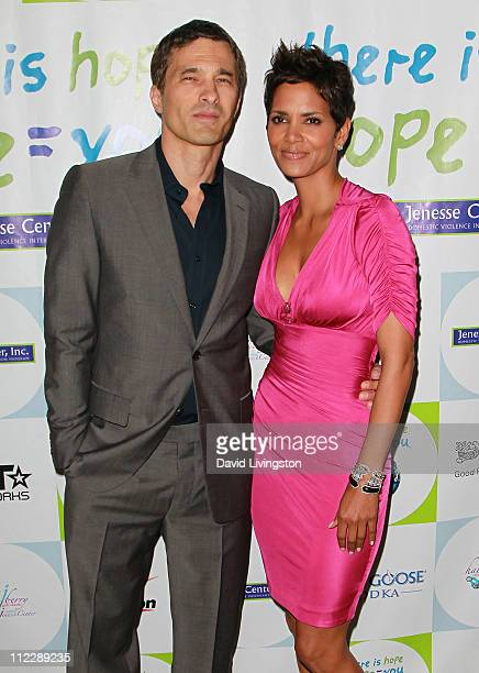Actors Olivier Martinez and Halle Berry attend the 2011 Jenesse Silver Rose Auction and Gala at the Beverly Hills Hotel on April 17, 2011 in Beverly...