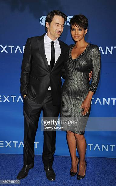 Actors Olivier Martinez and Halle Berry attend the Premiere Of CBS Films' 'Extant' at California Science Center on June 16 2014 in Los Angeles...