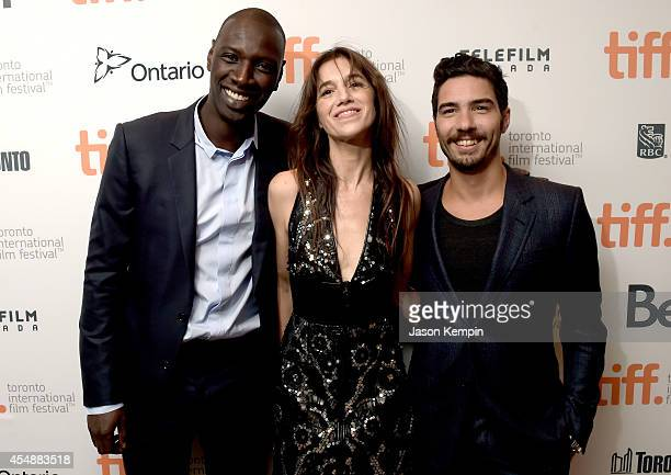 Actors Omar Sy Charlotte Gainsbourg and Tahar Rahim attend the Samba premiere during the 2014 Toronto International Film Festival at Roy Thomson Hall...