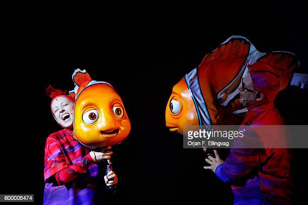 Actors on stage perform in Finding Nemo the Musical at The Disney Animal Kingdom part of Disney World in Orlando