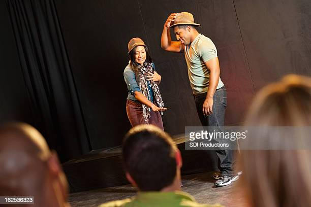 actors on stage performing in front of audience - actor stockfoto's en -beelden