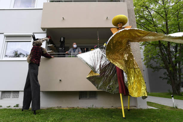 DEU: Performers Visit Munich Neighbourhood During The Coronavirus Crisis