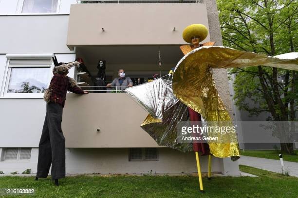 Actors on stilts from the group Foolpool perform in the streets of Mittelfeldstrasse quarter during the novel coronavirus crisis on May 29 2020 in...
