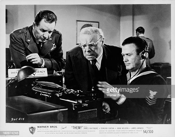 Actors Onslow Stevens and Edmund Gwenn with a Navy radioman in a scene from the film 'Them' featuring giant mutant killer ants 1954