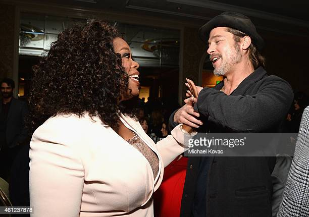 Actors Oprah Winfrey and Brad Pitt attend the 15th Annual AFI Awards Luncheon at Four Seasons Hotel Los Angeles at Beverly Hills on January 9 2015 in...