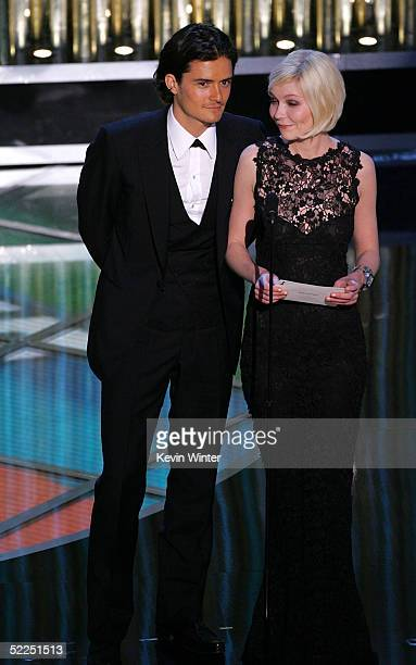 Actors Orlando Bloom and Kirsten Dunst present an award on stage during the 77th Annual Academy Awards on February 27 2005 at the Kodak Theater in...