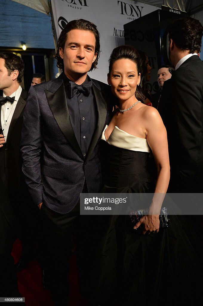 Actors Orlando Bloom and Lucy Liu attend the 68th Annual Tony Awards at Radio City Music Hall on June 8, 2014 in New York City.