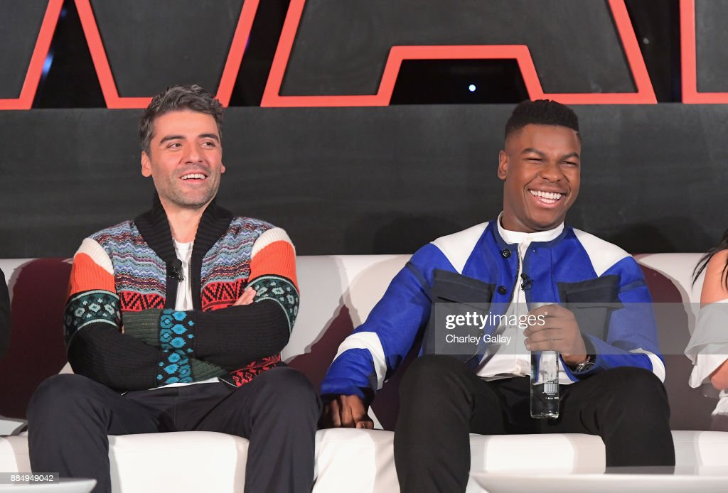 Actors Oscar Isaac (L) and John Boyega attend the press conference for the highly anticipated Star Wars: The Last Jedi at InterContinental Los Angeles on December 3, 2017 in Los Angeles, California.