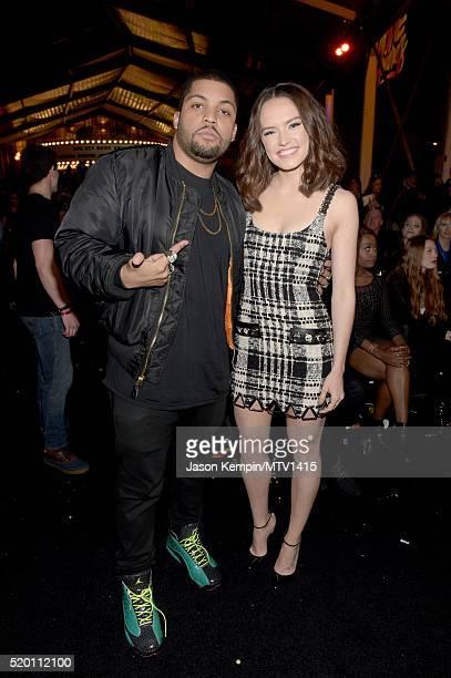 Actors O'Shea Jackson Jr and Daisy Ridley pose backstage at the 2016 MTV Movie Awards at Warner Bros Studios on April 9 2016 in Burbank California...