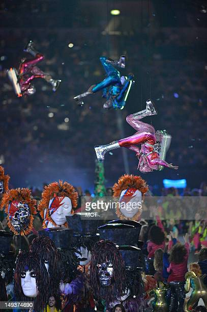 Actors outfitted in jet pack costumes perform during the Opening Ceremony for the London 2012 Summer Olympic Games at the Olympic Stadium in London...