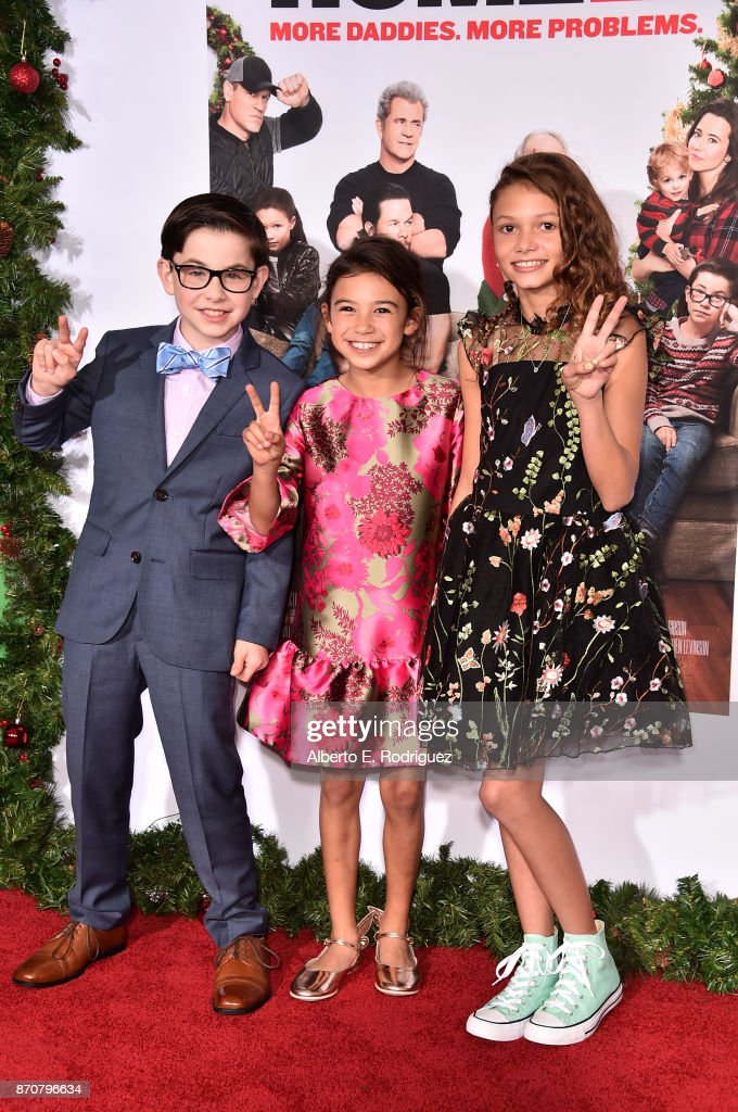 Actors Owen Wilder Vaccaro, Scarlett Estevez and Didi Costine attend the premiere of Paramount Pictures' 'Daddy's Home 2' at The Regency Village Theatre on November 5, 2017 in Westwood, California.