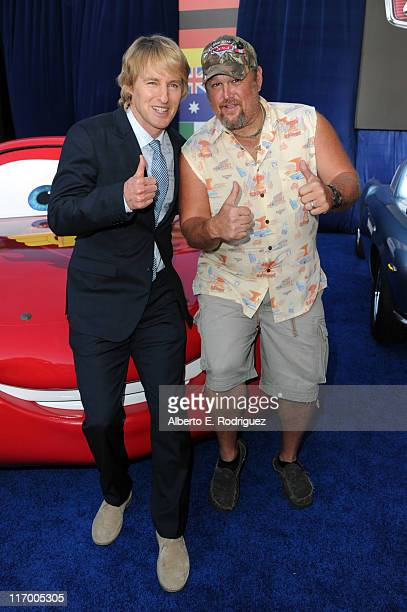 Actors Owen Wilson and Daniel Lawrence Whitney aka Larry the Cable Guy arrive at the premiere of Cars 2 presented by Walt Disney Pictures at the El...