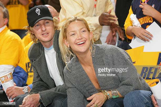 Actors Owen Wilson and Kate Hudson enjoy the game between the Golden State Warriors and the Dallas Mavericks in Game Six of the Western Conference...