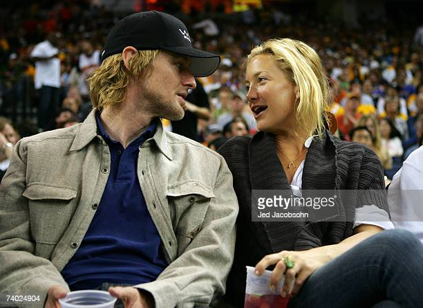 Actors Owen Wilson and Kate Hudson talk during the Dallas Mavericks and the Golden State Warriors Game Four of the Western Conference Quarterfinals...