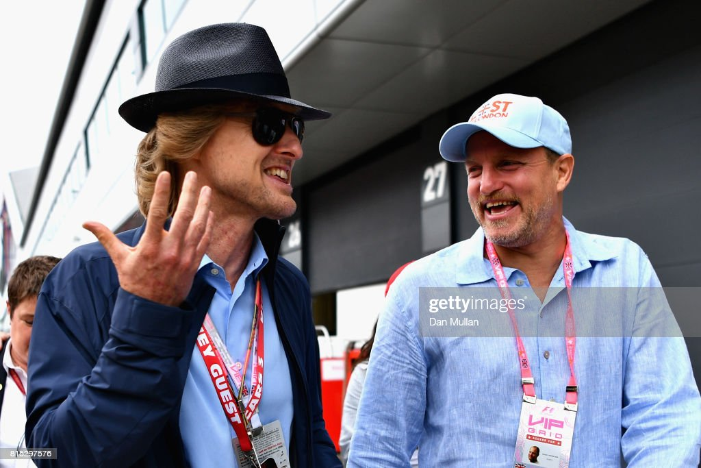 Actors Owen Wilson and Woody Harrelson walk in the Paddock before the Formula One Grand Prix of Great Britain at Silverstone on July 16, 2017 in Northampton, England.