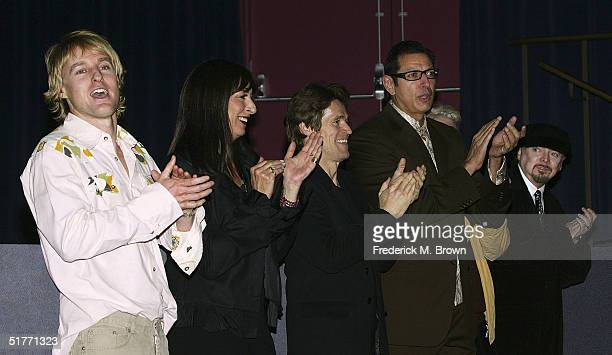 Actors Owen Wilson, Anjelica Huston, Willem Dafoe, Jeff Goldblum and Bud Cort react to introductions of the cast film during the film premiere of...