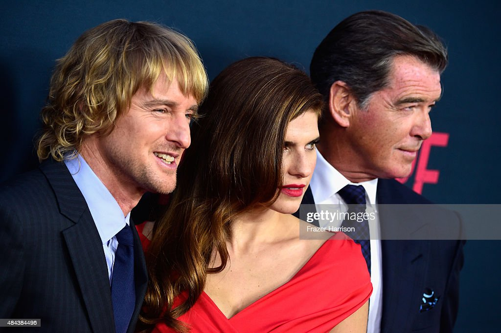 Actors Owen Wilson, Lake Bell and Pierce Brosnan arrive at The Premiere Of The Weinstein Company's 'No Escape' at Regal Cinemas L.A. Live on August 17, 2015 in Los Angeles, California.