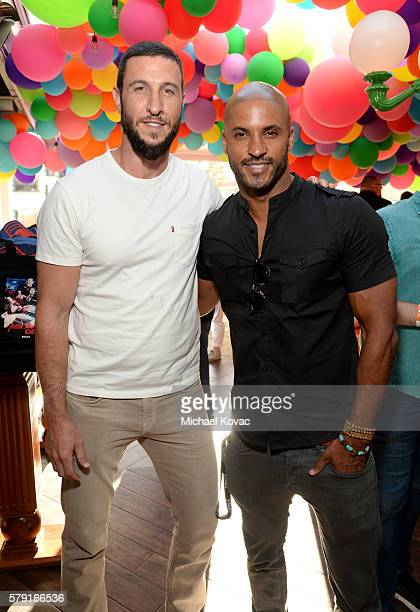 Actors Pablo Schreiber and Ricky Whittle attend the 'American Gods' autograph signing during ComicCon International at San Diego Convention Center on...