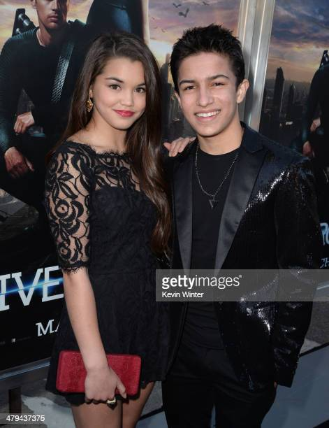 Actors Paris Bereic and Aramis Knight arrive at the premiere of Summit Entertainment's 'Divergent' at the Regency Bruin Theatre on March 18 2014 in...