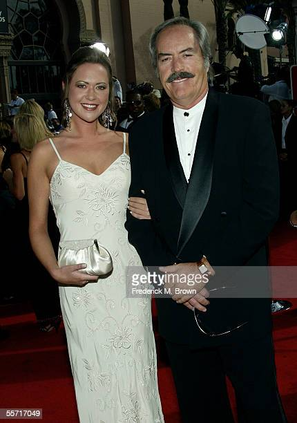 Actors Parisse and Powers Boothe arrive at the 57th Annual Emmy Awards held at the Shrine Auditorium on September 18 2005 in Los Angeles California
