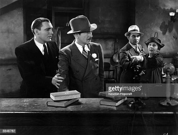 Actors Pat O'Brien and Adolphe Menjou in the Howard Hughes production 'The Front Page' the tale of a reluctant reporter's last story