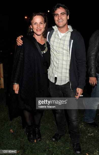 Actors Patricia Arquette and Joaquin Phoenix attends GiveLove Benefit Party on September 15 2011 in Beverly Hills California