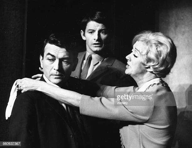 Actors Patrick Bedford Donal Donnelly and Madge Ryan rehearsing a scene from a play during rehearsals at the Lyric Theatre London circa 1965