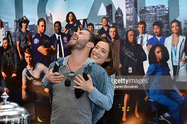 Actors Patrick John Flueger and Marina Squerciati goof around after signing a poster as they attends a press junket for NBC's 'Chicago Fire' 'Chicago...