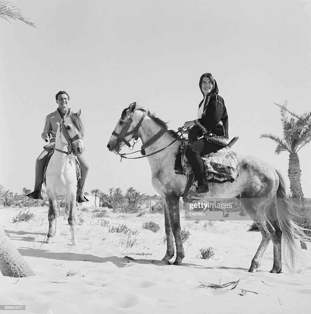 Actors Patrick McNee (1922 - 2015) and Katherine Woodville (1938 - 2013) honeymoon on the island of Djerba, 2nd May 1965.