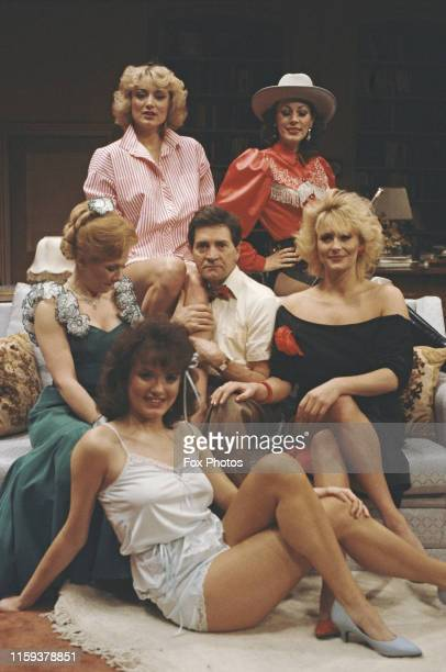 Actors Patrick Mower and Suzanne 'Suzi' Jerome pose with some of their costars in the play 'The Seven Year Itch' at the Albery Theatre in London 1985