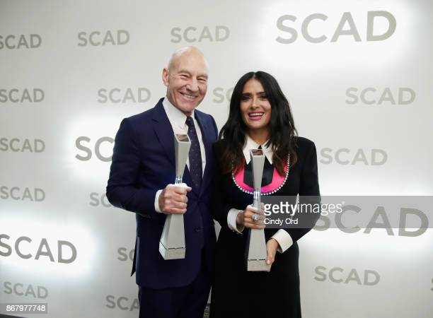Actors Patrick Stewart and Salma Hayek pose backstage with awards at Trustees Theater during the 20th Anniversary SCAD Savannah Film Festivalon...