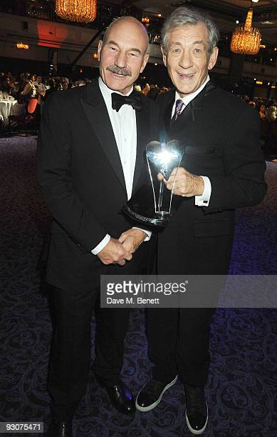 Actors Patrick Stewart and Sir Ian McKellen recipient of The Bernard Delfont Award for Outstanding Contribution to Showbusiness pose during the...